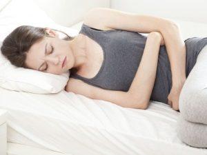 Боль внизу живота - симптом ВПЧ 56